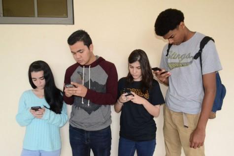 Phones taking over teens