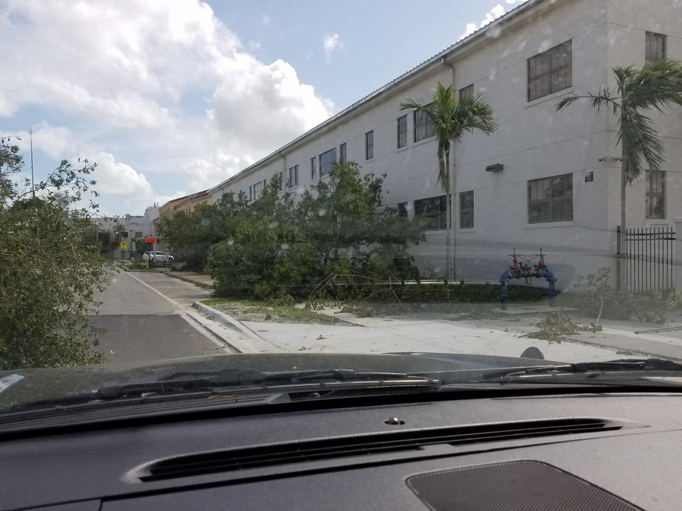 Principal Mr. Valdes drives by Miami High assessing minor damage done by Hurricane Irma.