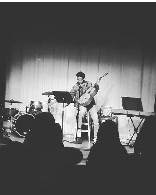 Kevin Martinez singing and playing guitar on the first Open Mic that took place on October 26.
