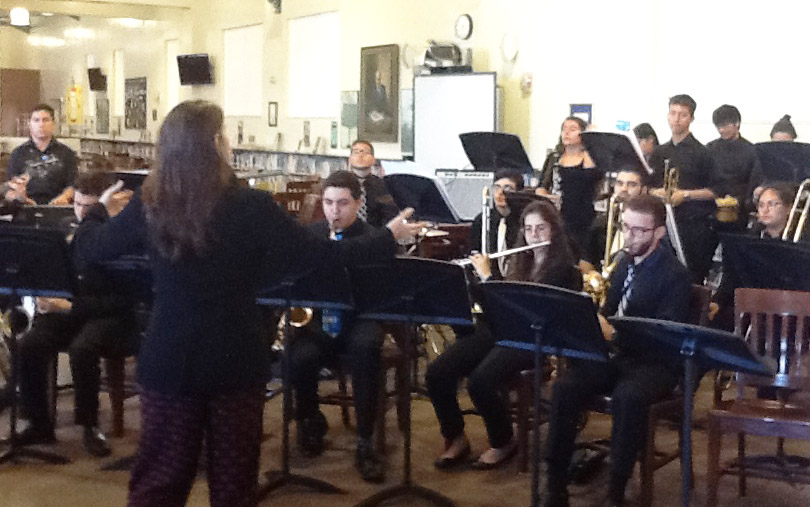Band performing for a luncheon, located in the library