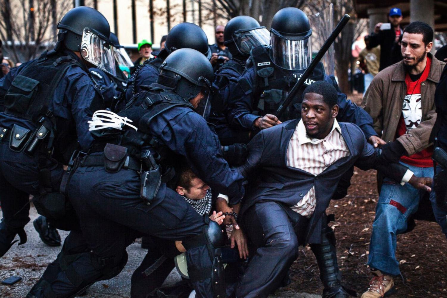 Bishop Derrick Robinson, who became a notable leader among the Ferguson protesters, was arrested by riot police while protesting in a public park (St. Louis, November 30, 2014).