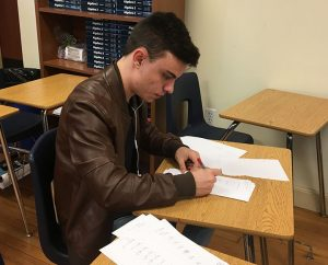 Honors student Emmanuel Garit is helping Ms. Munguia grade quizzes.