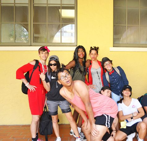 Students pose in front of the cafeteria sporting their Gender Swap Day costumes.