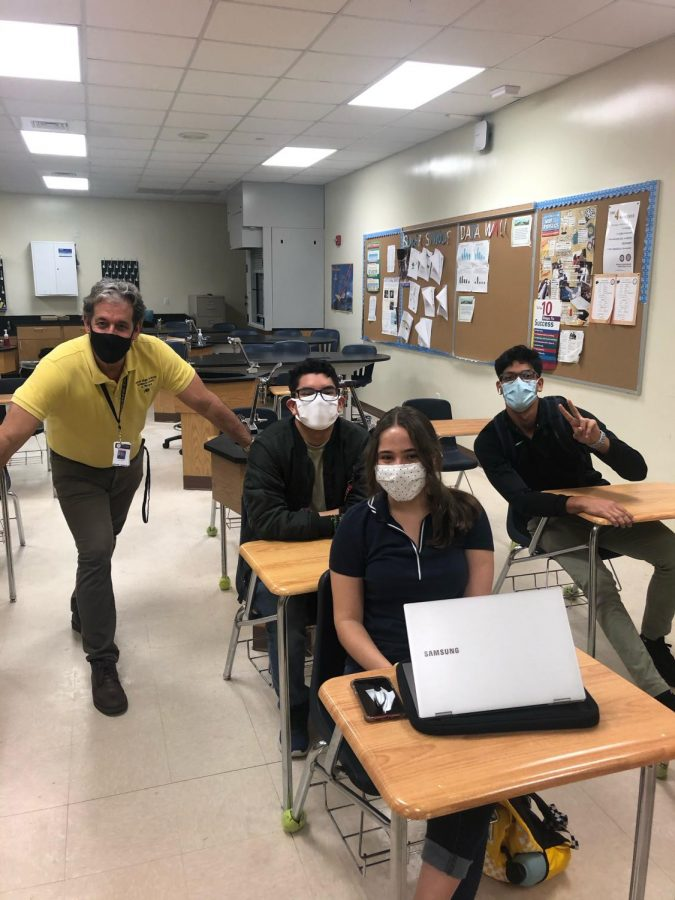 Mr. Rivera next to his Physics students.