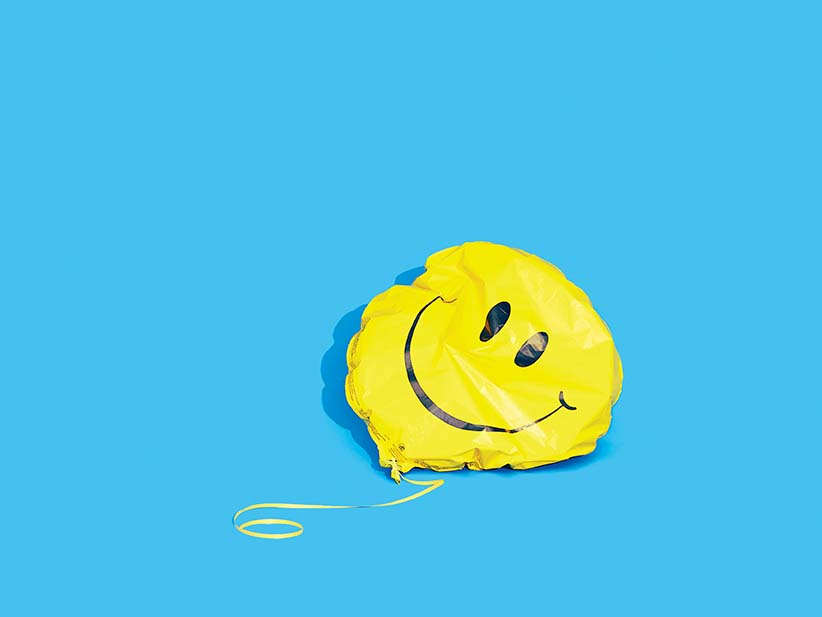 Deflated smiley face balloon.